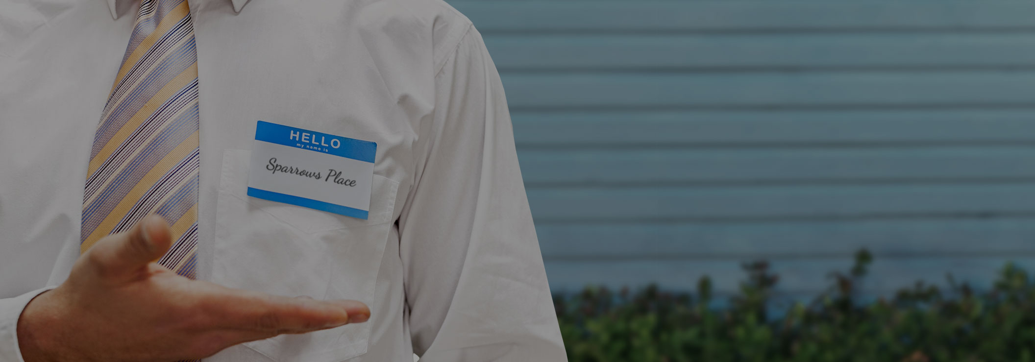 man's white business shirt with a nametag reading Sparows Place